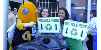 Image of Buzz with students holding recycling signs
